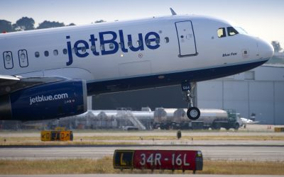 JetBlue CEO says flight bookings for holiday season have not yet been hurt by rising Covid cases